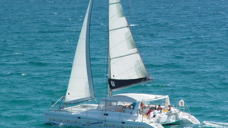 Catamaran Rental in Sitges. BBQ on board for groups up to 37 guests. Party boat.